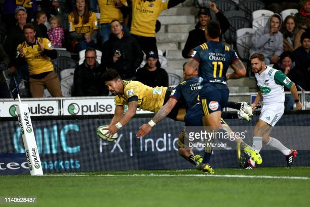 Ardie Savea of the Hurricanes dives over to score a try during the round 8 Super Rugby match between the Highlanders and Hurricanes at Forsyth Barr...
