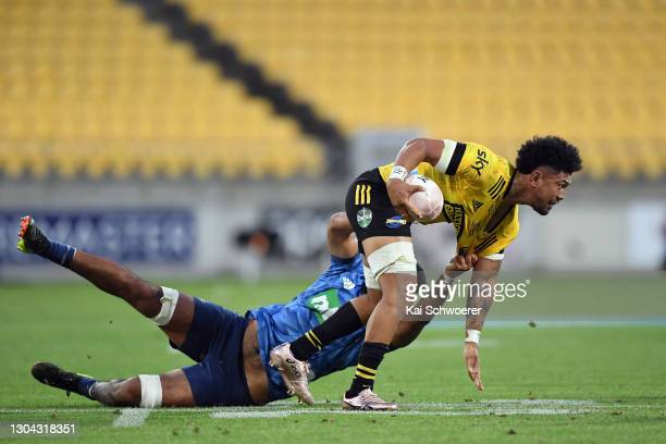 Ardie Savea of the Hurricanes is tackled by Akira Ioane of the Blues during the round one Super Rugby Aotearoa match between the Hurricanes and the...