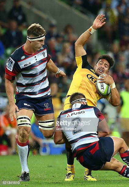 Ardie Savea of the Hurricanes is tackled by James Hanson of the Rebels during the round eight Super Rugby match between the Rebels and the Hurricanes...
