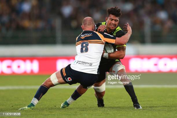 Ardie Savea of the Hurricanes is tackled by Lachlan McCaffrey of the Brumbies during the round three Super Rugby match between the Hurricanes and the...