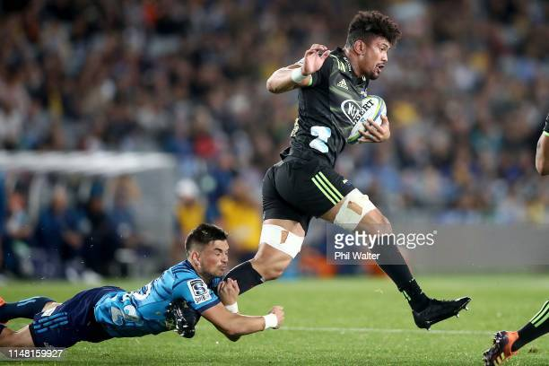 Ardie Savea of the Hurricanes is tackled by Ottere Black of the Blues during the round 13 Super Rugby match between the Blues and the Hurricanes at...