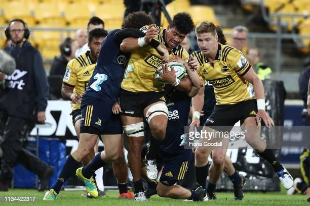 Ardie Savea of the Hurricanes is tackled during the round 4 Super Rugby match between the Wellington Hurricanes and Otago Highlanders at Westpac...
