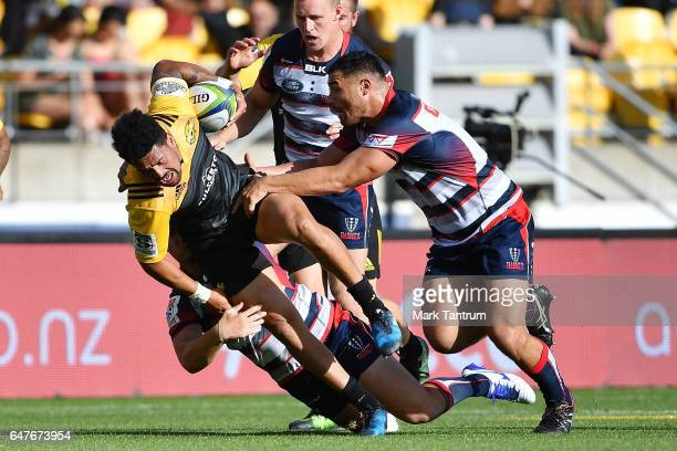 Ardie Savea of the Hurricanes is tackled during the round two Super Rugby match between the Hurricanes and the Rebels at Westpac Stadium on March 4...