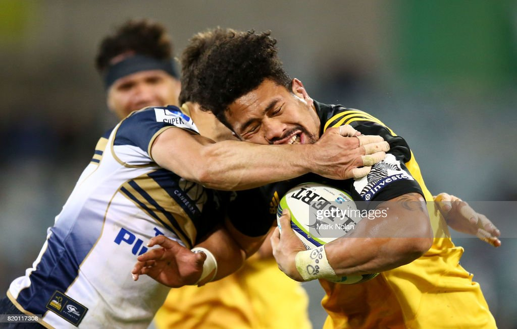 Ardie Savea of the Hurricanes is tackled during the Super Rugby Quarter Final match between the Brumbies and the Hurricanes at Canberra Stadium on July 21, 2017 in Canberra, Australia.