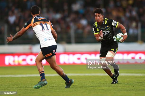 Ardie Savea of the Hurricanes looks to evade Chance Peni of the Brumbies during the round three Super Rugby match between the Hurricanes and the...