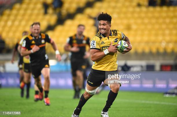 Ardie Savea of the Hurricanes makes a break during the round 11 Super Rugby match between the Hurricanes and Chiefs at Westpac Stadium on April 27...