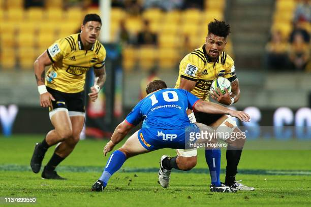Ardie Savea of the Hurricanes runs at Jean-Luc du Plessis of the Stormers during the round six Super Rugby match between the Hurricanes and the...