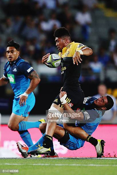 Ardie Savea of the Hurricanes runs over Bryn Hall of the Blues during the round three Super Rugby match between the Blues and the Hurricanes at Eden...