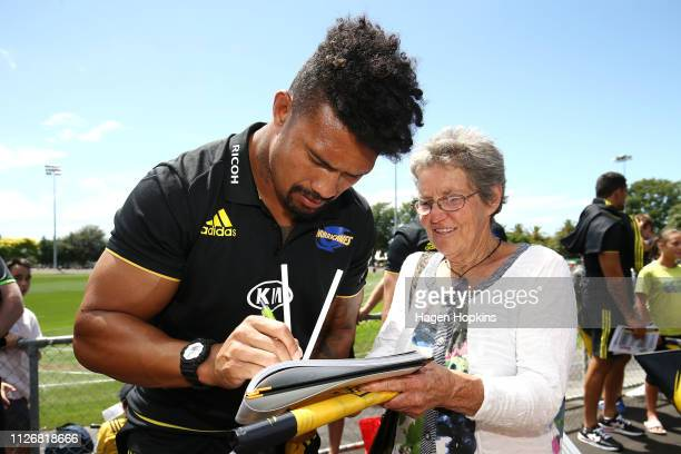 Ardie Savea of the Hurricanes signs an autograph during the preseason Super Rugby match between the Hurricanes and the Crusaders on February 02 2019...