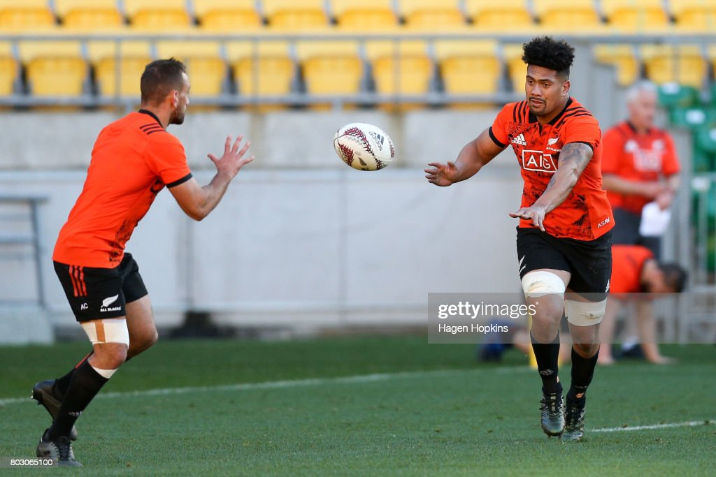 Ardie Savea passes to Aaron Cruden during a New Zealand All Blacks training session at Westpac Stadium on June 29, 2017 in Wellington, New Zealand.