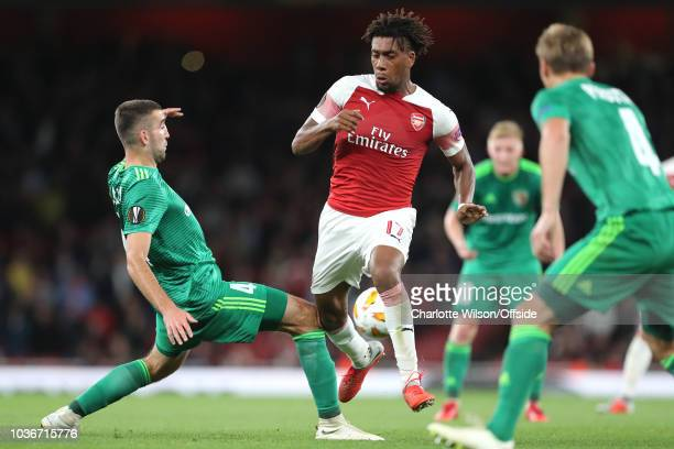 Ardin Dallku of Vorskla and Alex Iwobi of Arsenal knock knees during the UEFA Europa League Group E match between Arsenal and Vorskla Poltava at...