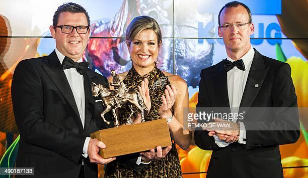 ArdJan Kooren head of Kotug receives from Dutch queen Maxima the King Willem I Award for an SME business in the headquarter of the Dutch Bank in...