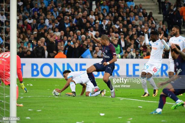 PSG are denied a penalty even though Jordan Amavi of Marseille appears to put his hand on the ball during the Ligue 1 match between Olympique...