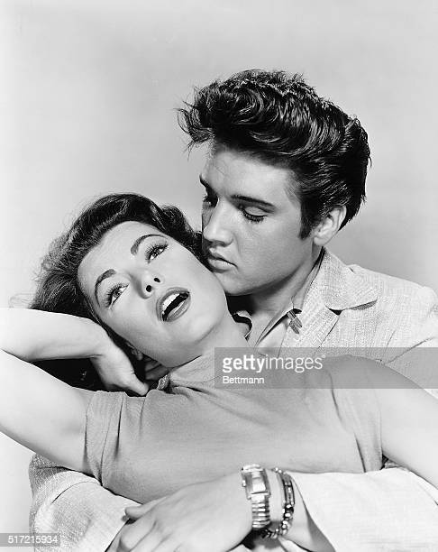 DRAMATIC SWEETHEARTS are Elvis Presley and Judy Tyler with Presley playing his most dramatic role in MGM's 'Jailhouse Rock' and also introducting six...