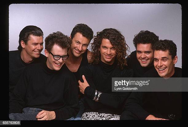 Tim Farris Kirk Pengilly Garry Gary Beers Michael Hutchence Andrew Farris and Jon Farris
