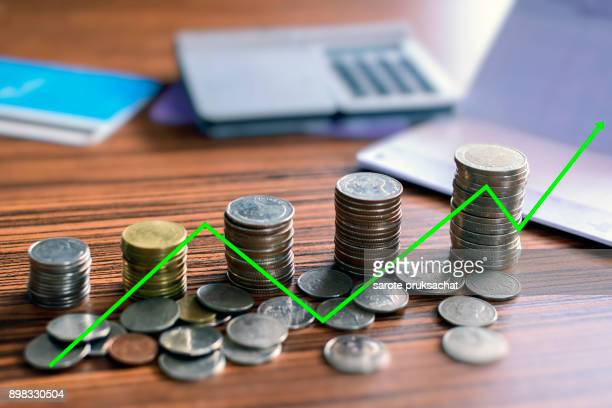 are grow up on coins stack for money saving for investment financial concept .