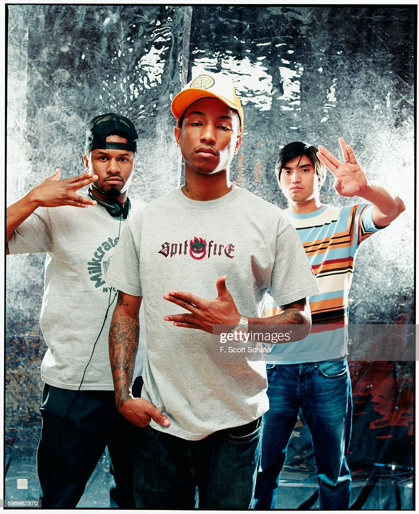Sheldon Shay Haley, Pharrell Williams and Chad Hugo) are photographed for Request Magazine in 2002.