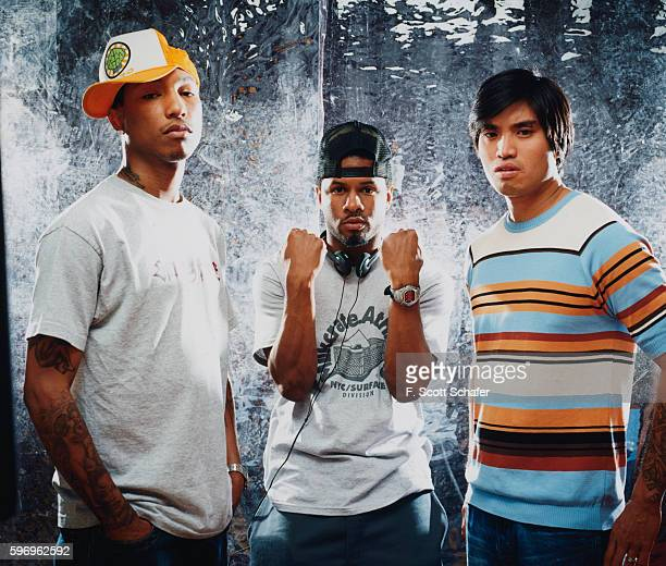 Pharrell Williams Sheldon Shay Haley and Chad Hugo are photographed for Request Magazine in 2002