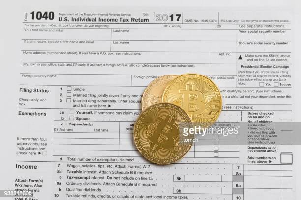 are the bitcoins subject to declaration? - 1040 tax form stock photos and pictures