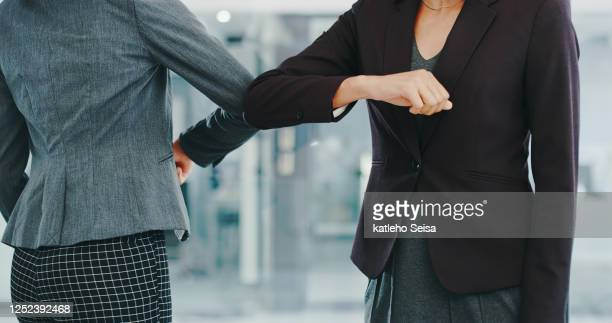are the days of the handshake over? - employee engagement stock pictures, royalty-free photos & images