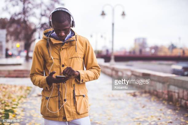 are young people really addicted to cell phones and social media? - yellow coat stock pictures, royalty-free photos & images