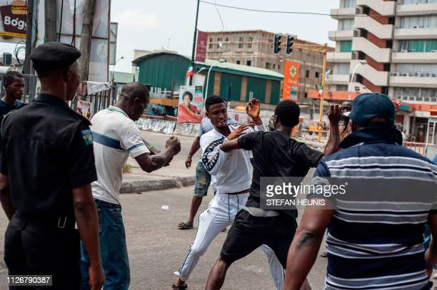 Area Boys fight over the alleged distribution of money for votes at a polling unit in AlagomejiYaba in Lagos on February 23 2019 Nigerians voted for...