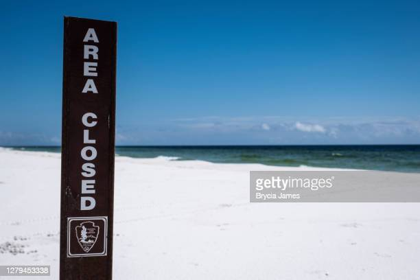 area closed sign at gulf shores national seashore - brycia james stock pictures, royalty-free photos & images