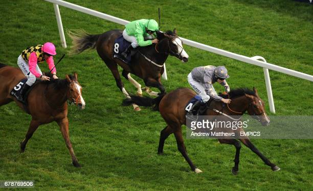 Area Fifty One ridden by Jockey Jamie Spencer comes home ahead of Clayton ridden by Neil Callan and Vasily ridden by Andrea Atzeni to win the...