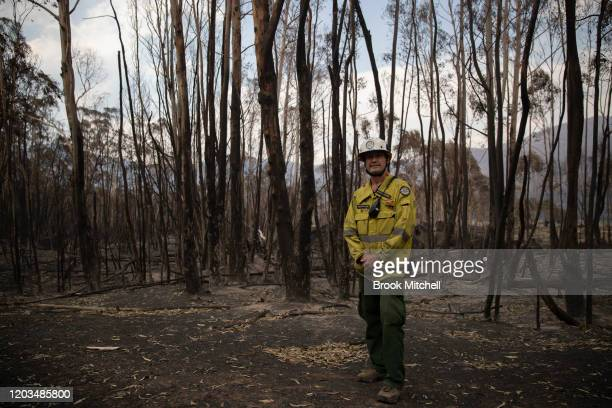 Area manager of the Namadgi National Park Brett McNamara stands among the devastated bushland of the park he works to protect February 02 2020 in...