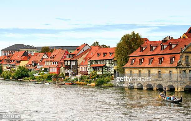 Area of the UNESCO World Heritage Site of Bamberg, known as Little Venice. Gondola with tourists on the River Regnitz.
