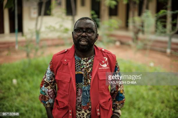 Area Program Manager of NGO Save the Children, Caleb Odhiambo speaks to AFP at the refugee Dadaab complex camp, in the north-east of Kenya, on April...