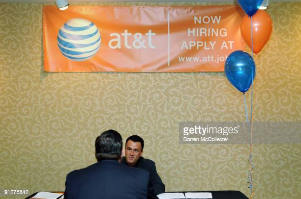 Area Retail Sales Manager Joshua Mailloux interviews a prospective employee at an AT&T job fair September 30, 2009 at the Hilton Dedham in Dedham,...