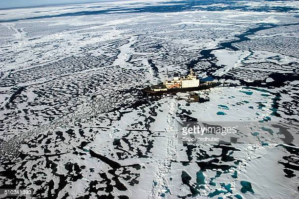 areal shot of ice breaker heading in ne passage - ice floe stock pictures, royalty-free photos & images