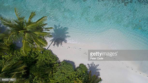 areal view of footprints on island beach - footprint stock pictures, royalty-free photos & images