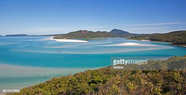 Areal view of white sandy beaches and turquoise blue water in the bay of Whitehaven Beach on Whitsunday Island in the Coral Sea, Queensland,...
