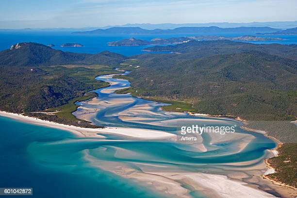 Areal view of white sandy beaches and turquoise blue water of Whitehaven Beach on Whitsunday Island in the Coral Sea, Queensland, Australia.