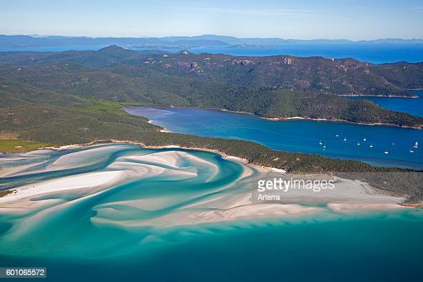Areal view of white sandy beaches and turquoise blue water of Whitehaven Beach on Whitsunday Island in the Coral Sea Queensland Australia
