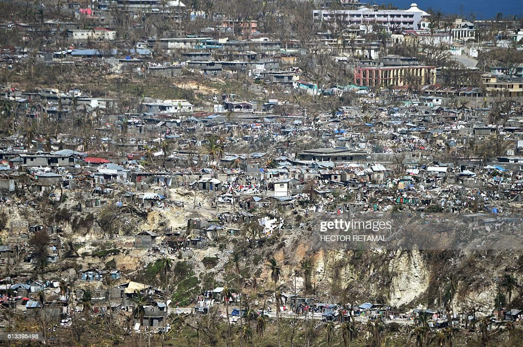 Areas of Jeremie, Haiti, destroyed by Hurricane Matthew are seen on October 8, 2016. The full scale of the devastation in hurricane-hit rural Haiti became clear as the death toll surged over 400, three days after Hurricane Matthew leveled huge swaths of the country's south. / AFP / HECTOR