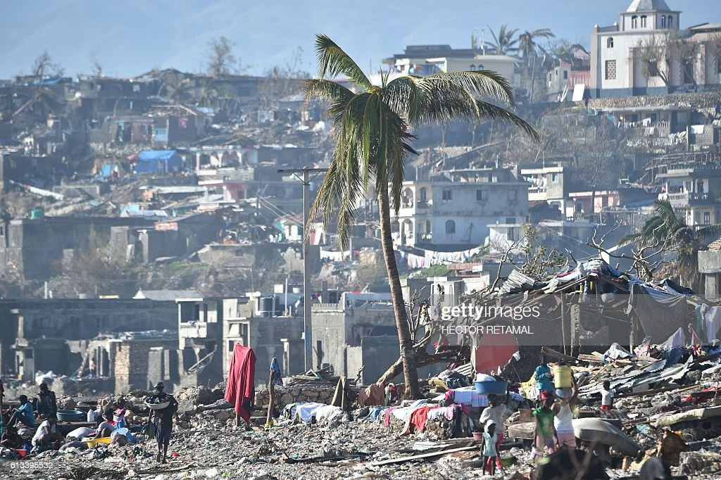 TOPSHOT - Areas of Jeremie, Haiti, destroyed by Hurricane Matthew are seen on October 8, 2016. The full scale of the devastation in hurricane-hit rural Haiti became clear as the death toll surged over 400, three days after Hurricane Matthew leveled huge swaths of the country's south. / AFP / HECTOR