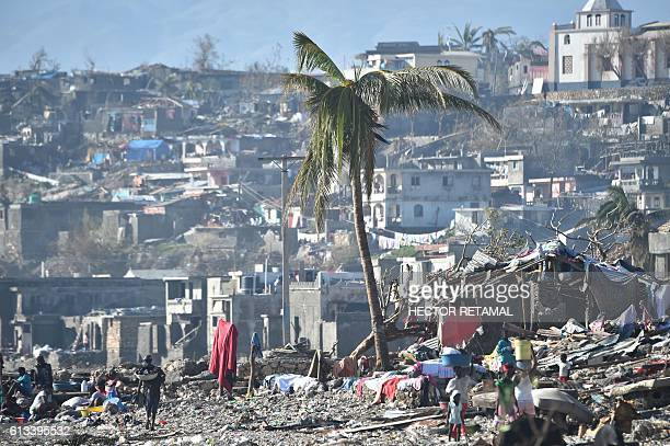 TOPSHOT Areas of Jeremie Haiti destroyed by Hurricane Matthew are seen on October 8 2016 The full scale of the devastation in hurricanehit rural...