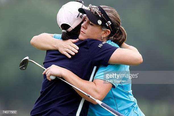 Aree Song gets a hug from AJ Eathorne after they finished the round on the 9th hole during the first round of the SemGroup Championship presented by...