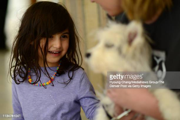 Areli Fladen of Broomfield left meets 4 month old puppy named Merlowe at Governor's Mansion on Saturday March 9 2019 First Gentleman Marlon Reis...