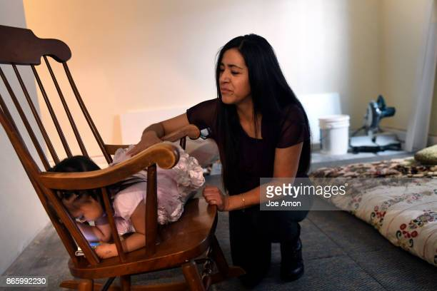 Areli GonzalezLopez almost 2 has already found a favorite chair to watch cartoons on her mothers phone in the basement of the Parsonage of the Two...