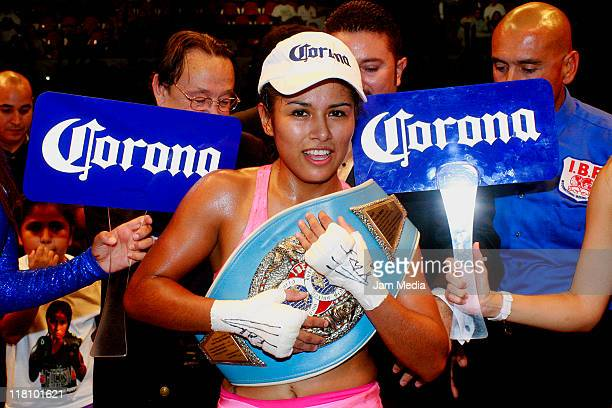 Arely Muicino of Mexico celebrates victory over Soledad Macedo of Uruguay during the FIB World Flyweight Beautiful and Dangerous championship at...