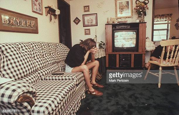 Aren Almon mother of 1yrold Baylee killed in terrorist bombing of Alfred P Murrah Federal Building pensively sitting on sofa at home a day before her...
