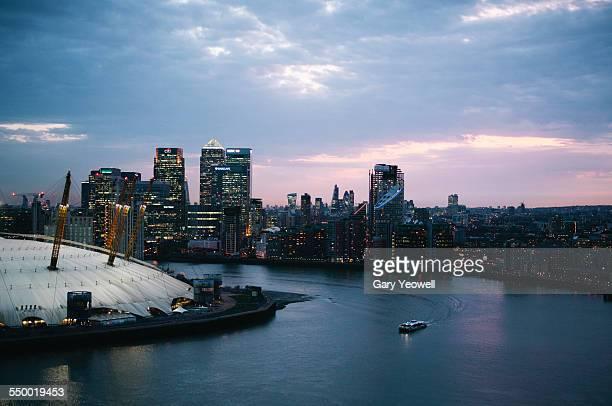 02 Arena, Canary Wharf and City skyline at dusk
