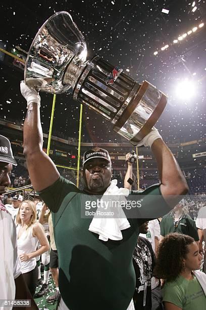 Arena Football ArenaBowl XVIII San Jose SaberCats victorious with James F Foster trophy after game vs Arizona Rattlers Phoenix AZ 6/27/2004