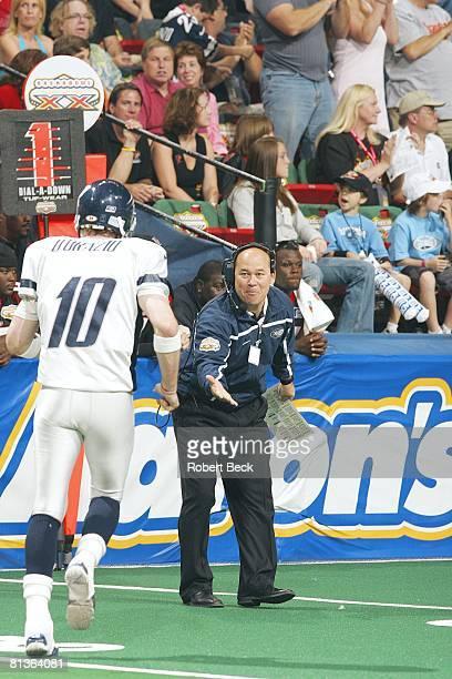 Arena Football ArenaBowl XX Chicago Rush coach Mike Hohensee victorious with QB Matt D'Orazio after throwing touchdown pass vs Orlando Predators Las...