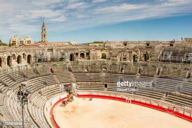 arena of nimes, a roman arena in the south of france - 円形劇場 ストックフォトと画像