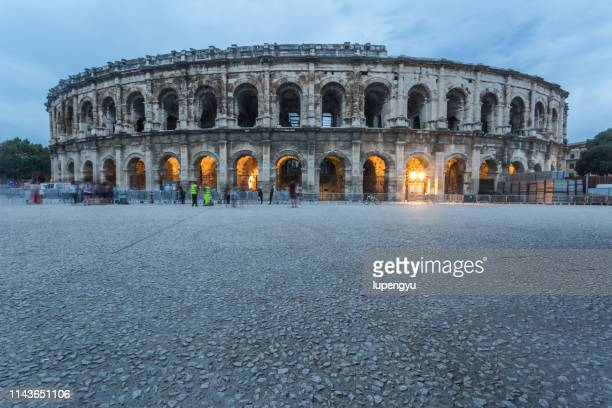 arena of nimes at night, languedoc-roussillon, france - nimes photos et images de collection